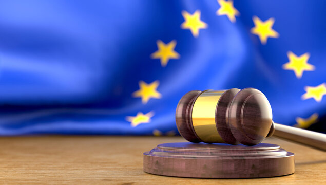 Judge's gavel with the flag of Europe in the background