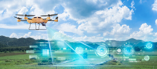 Obraz 5G technology trend and smart farm agriculture concept.Farmer use ai drone to monitor prediction forecast check of plant field.Agriculture drone fly for research analysis,terrain scanning. - fototapety do salonu