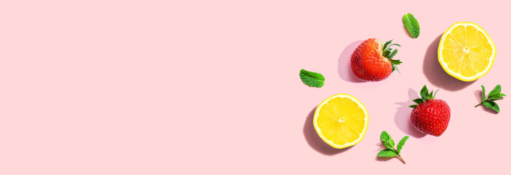 Fresh lemons and strawberries with mints