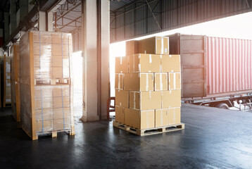Stacked of Package Boxes Load into Cargo Container. Truck Parked Loading at Dock Warehouse. Delivery Service. Shipping Warehouse Logistics. Shipment Freight Truck Transportation.