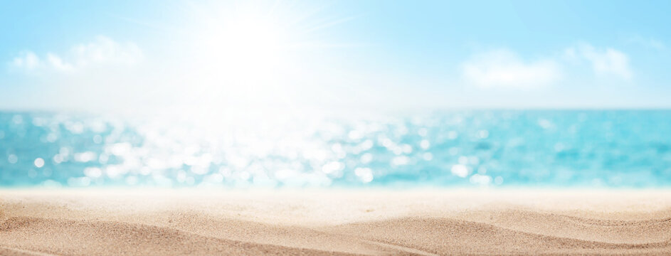 Sea beach with hot sand and sunny bokeh