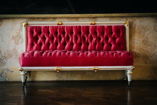 red sofa on the floor, vintage sofa