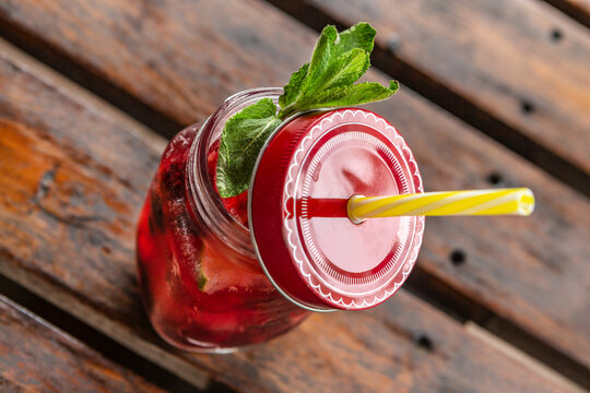 portrait of a fruity non-alcoholic summer drink, outdoors