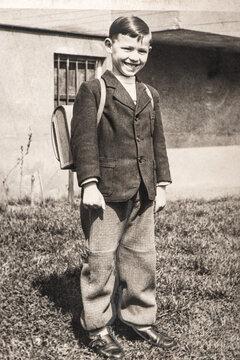 Vintage photo of school boy. Old image with original film grain