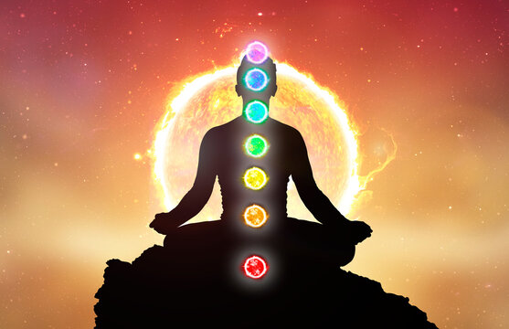 Chakras and meditating men in yoga lotus position. Mindfulness and self awereness practice. Silhiuette of meditation with chakras on sun background.