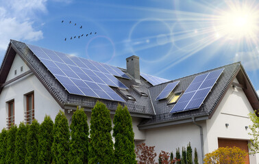 Fototapeta Beautiful modern house with solar panels. Clear sky, sun. obraz