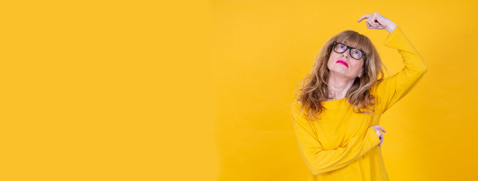 adult woman thinking isolated on yellow