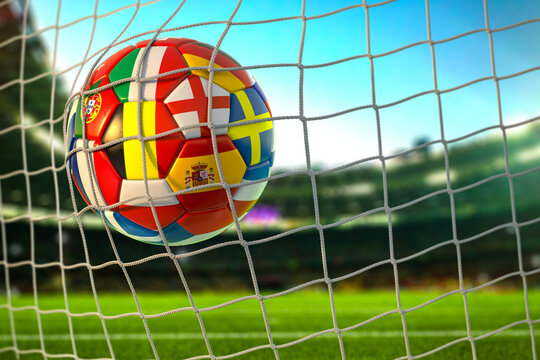 Soccer football ball with flags of european countries in the net of goal on football stadium. Euro championship 2021.