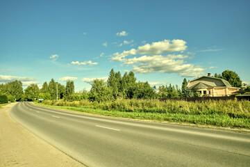 Fototapeta Asphalt road among hills and green grass. obraz