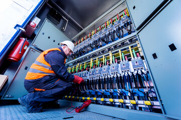Fototapeta Checking the operating voltage levels of the solar panel switchgear compartment obraz