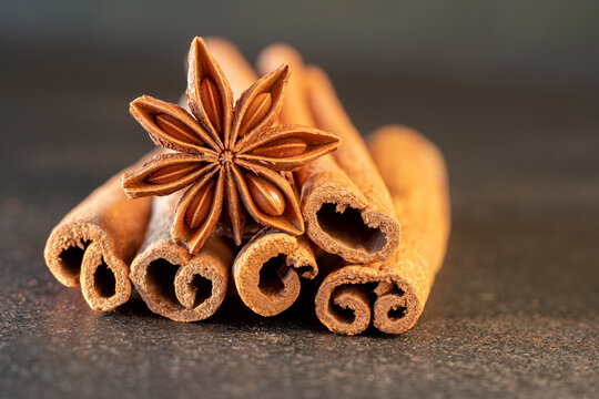 Traditional Christmas spices - Star anise with cinnamon on old table.