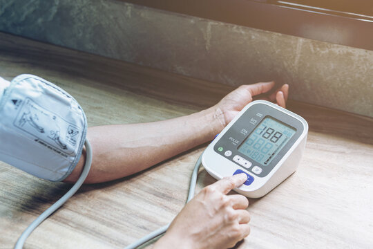Woman is taking care for health with hearth beat monitor and blood pressure. Health care.