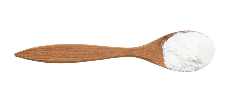 top view of baking powder in wood spoon isolated