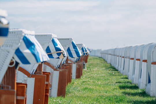 rows of beach chairs on meadow