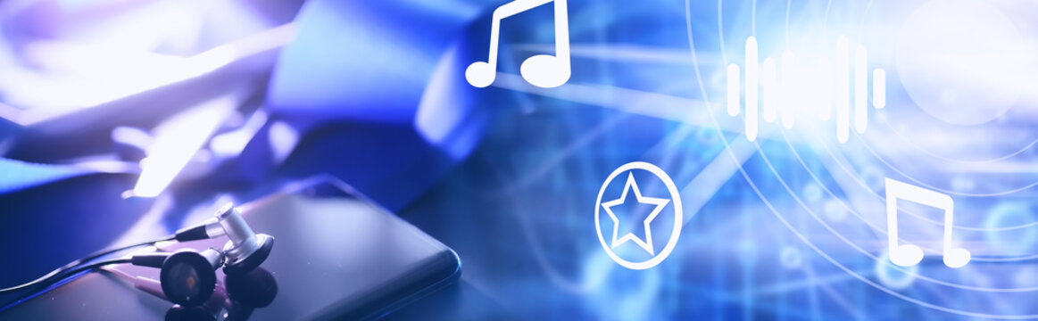 Mobile phone and earphones on the table. Listen to music on the go. Online player. Audio applications for smartphones.