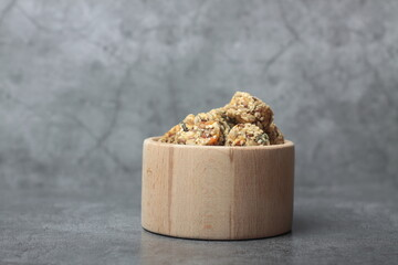 Obraz Healthy eating concept - a bowl of crunchy on gra background - fototapety do salonu