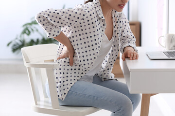 Obraz Woman suffering from back pain in office, closeup. Bad posture problem - fototapety do salonu