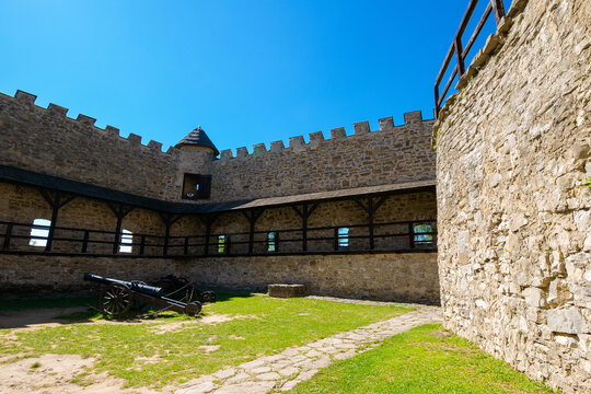 Stara Lubovna, Slovakia - 28 AUG 2016: ancient cannon in the inner courtyard of the castle. great stone walls of a fortrece. popular travel destination
