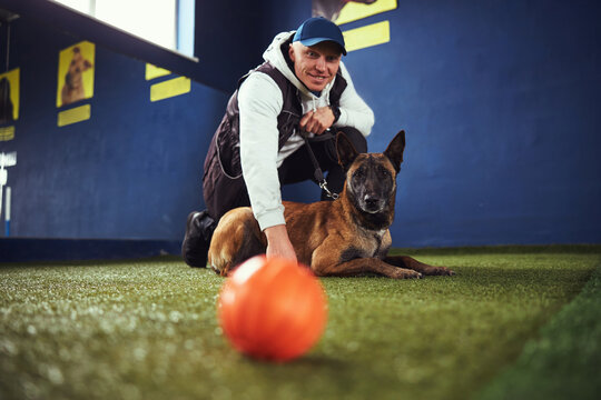 Contented instructor and a serious canine looking ahead