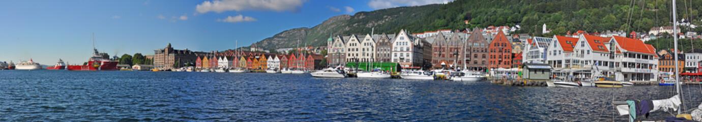 Panoramic view along harbor of Bergen with its landmark Bryggen, Norw