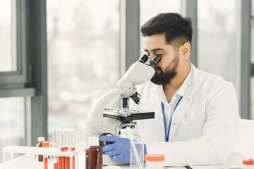 Fototapeta laboratory, microscope, research, science, scientist, person, analyzing, biochemistry, chemistry, doctor, medicine, male, man, adult, analysis, discovery, medical, technician, technology, biology obraz