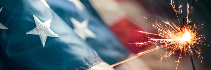 Fototapeta Close-up Of Vintage American Flag With Sparkler And Smoke - Fourth Of July Background  obraz