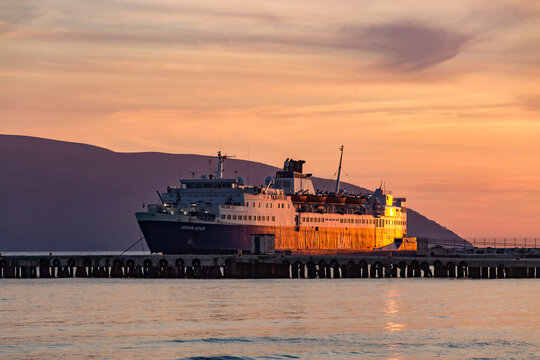 Vlore, Albania - 21 May 2021: Big Passenger ferry Ship Ionian Star that operates on route Vlore Albania -Brindizi Italy on sunset background in Vlore city port.