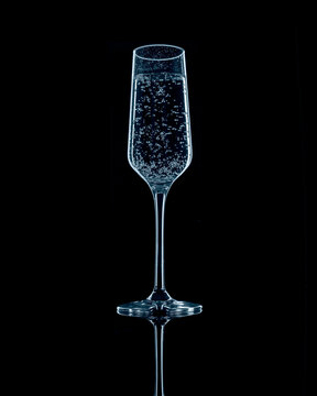 Champagne flute with bubbles light with blue