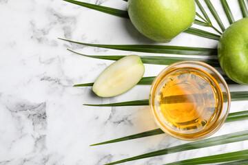 Obraz Fresh juice, apples palm leaf on white marble table, flat lay - fototapety do salonu