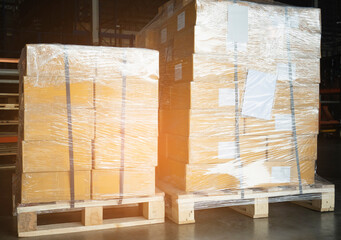 Stacked of Package Boxes Wrapped Plastic Film on Pallet at Storage Warehouse. Shipment Boxes. Cargo Export- Import.