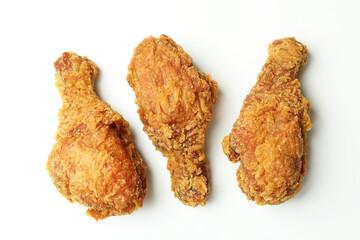 Tasty fried chicken on white background, close up