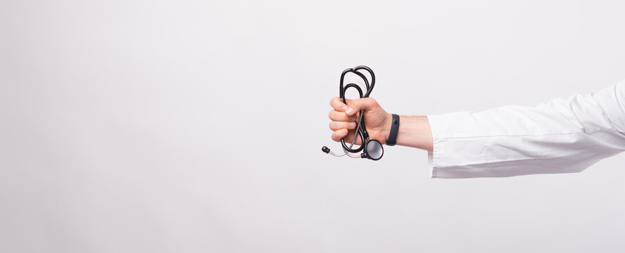 Male doctor hand holding Stethoscope over white background