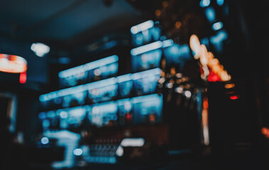 Obraz Blurred bar shelves and bar counter with many bottles - fototapety do salonu