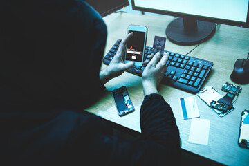 Male hacker is trying to access the phone. Security and protection of personal data. The concept of cyber crime and hacking - fototapety na wymiar