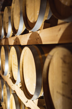 Close up view of multiple wooden barrels at gin distillery