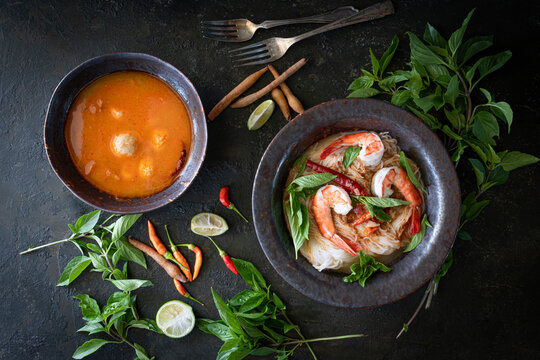 Thai Rice Noodles in shrimp Curry Sauce with ingradient on wooden table