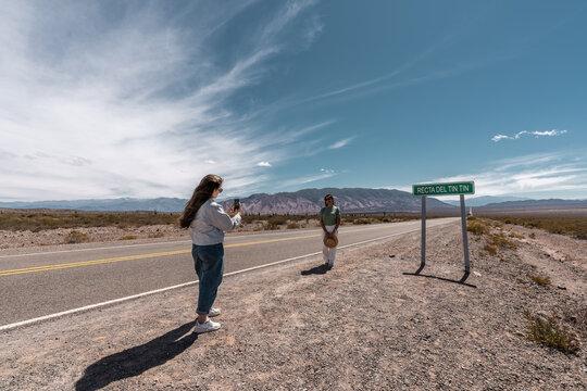 Young hispanic woman taking a picture to a hispanic senior woman - latinx people
