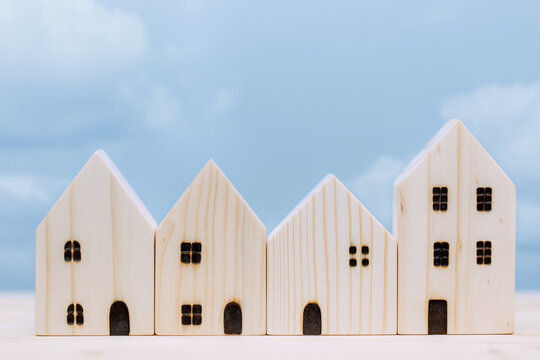 wooden home small model with blue sky for village good house city urban community concept.