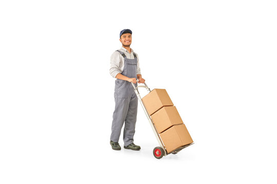 Delivery man pushing and pointing out hand truck, trolley isolated on white background.