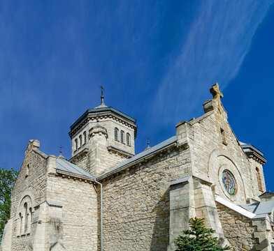 Old stone church of the early 20th century on a background of blue sky