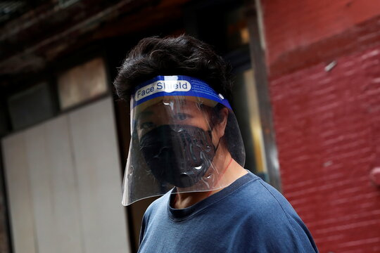 A woman wearing a protective face mask walks in Manhattan's Chinatown district following the May 31, 2021 unprovoked attack on a 55 year old Asian woman, in New York City