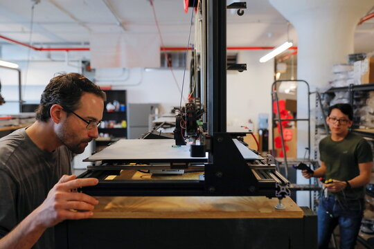 Co-founder and Co-CEO Gordon LaPlante and print service manager Leonardo Chiang work with large format FDM 3D printers at gCreate, a 3D printer manufacturer, in New York City
