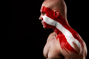 Obraz Austria fan. Soccer or football athlete with flag bodyart on face. Sport concept with copyspace. - fototapety do salonu