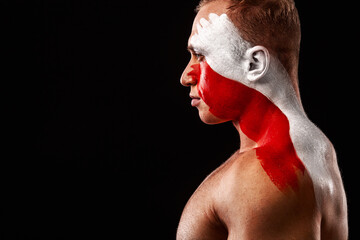 Obraz Switzerland fan. Soccer or football athlete with flag bodyart on face. Sport concept with copyspace. - fototapety do salonu