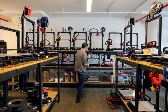 Co-founder and Co-CEO Gordon LaPlante works amongst large format FDM 3D printers at gCreate, a 3D printer manufacturer, in New York City