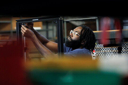 3D Printer Assembly Team Member Kaome O'Faire works at gCreate, a 3D printer manufacturer, in New York City