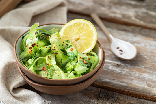 Fresh salad with armenian cucumber, dry chili and herbs