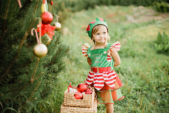 Christmas in july. Child waiting for Christmas in wood in july.