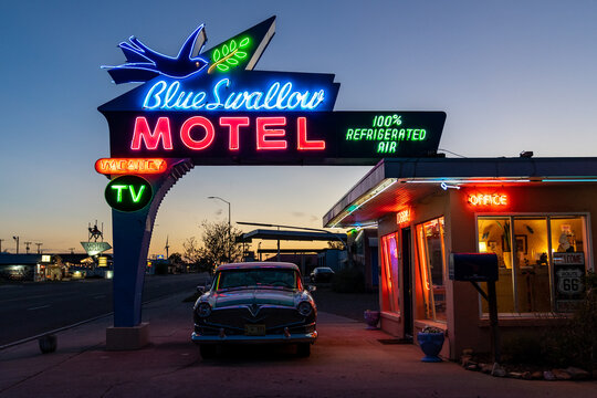 Tucamcari, New Mexico - May 6, 2021: Close up of the Blue Swallow Motel neon sign, a famous classic Route 66 motel