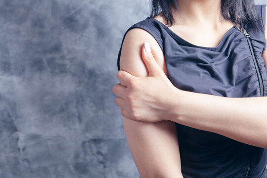 young woman's arm hurts